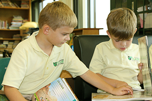 Boys reading in the Monsignor Slade library.